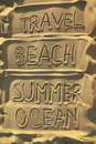 Words on sand - travel, beach, summer and ocean Stock Photos