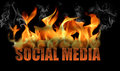 This is the words social media in flames with fire and smoke and steam coming off it is horizontal on a black background Stock Image