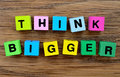The words Think Bigger on table Royalty Free Stock Photo