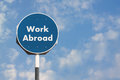 Work abroad sign a photo of a Stock Photo