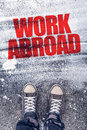Work abroad title on the pavement Royalty Free Stock Photo