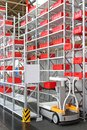 Work assistance vehicle high shelving warehouse Stock Image