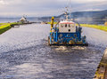 Work boat on calendonian canal scotland approaching the clachnaharry sea lock the near inverness uk Royalty Free Stock Photography