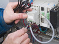 Work for electrician technicians on the open enclosure repairs to electronic components Stock Image