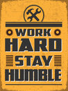 Work hard stay humble retro grunge poster with life quote for your station Stock Image