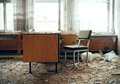 Work of horror an old desk with a chair surrounded by rubble Royalty Free Stock Photos