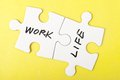 Work and life words written on two pieces of jigsaw puzzle Stock Images