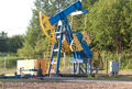 Work of oil pump jack on a field Stock Photography