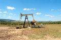 Work of oil pump jack on a field Stock Photo
