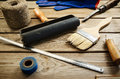 Work and painting tools on the wooden background. horizontal Royalty Free Stock Photo