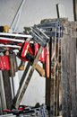 Work table of a carpenter with many tools olds hanging Royalty Free Stock Photo