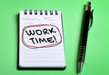Work time word on notebook page Royalty Free Stock Photo