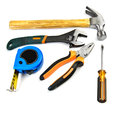 Work tools hammer pliers wrench screwdriver and tape measure over white background Royalty Free Stock Photos