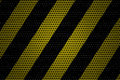 Work yellow and black painted metal and perforated background Royalty Free Stock Images