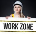 Work zone sign on template board, worker woman Royalty Free Stock Images
