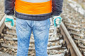 Worker with adjustable wrench on the railroad in winter Royalty Free Stock Photo