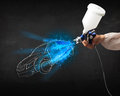 Worker with airbrush gun painting hand drawn car lines white Royalty Free Stock Photography