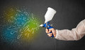 Worker with airbrush gun paints colorful lines and splashes concept Stock Photos