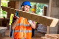Worker bring construction timber young at work Stock Photo