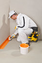 Worker brush waterproofing Royalty Free Stock Image