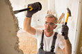 Worker builder demolish wall with tool Royalty Free Stock Photo