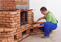 Worker building masonry heater Royalty Free Stock Photos