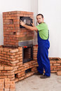 Worker building a masonry heater Royalty Free Stock Images