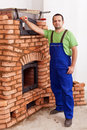 Worker building a masonry heater Royalty Free Stock Photos