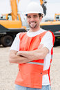 Worker at a building site working with heavy machinery Royalty Free Stock Photography
