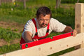 Worker building wooden fence Royalty Free Stock Photo