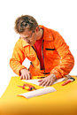 Worker carefully folds a paper sheet Stock Photo