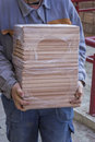 Worker carries packages of beech wood profiles 4 Royalty Free Stock Photo