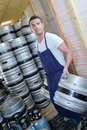 Worker carrying barrels beer at brewery Royalty Free Stock Photo