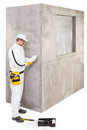 Worker checking the primer before preparing cement base for tile or insulation adhesive Royalty Free Stock Images