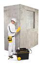 Worker checking the primer before preparing cement base for tile or insulation adhesive Stock Photography