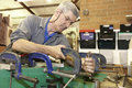 Worker and clamps Stock Images