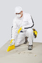 Worker clean cement base with brush-broom Stock Image