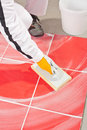 Worker clean with sponge trowel tile joints grout Stock Photos