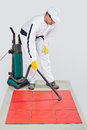 Worker clean tiles on floor and joints Royalty Free Stock Images