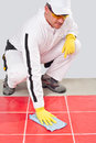 Worker cleans white joints Stock Photos