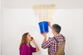 Worker Collecting Water In Bucket From Ceiling Royalty Free Stock Photo