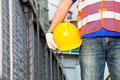 Worker on construction site with helmet or hard hat Royalty Free Stock Photos