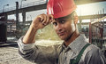 Worker at a construction site working on the background of the Royalty Free Stock Images