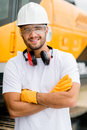 Worker at a construction site working with heavy machines Royalty Free Stock Photos