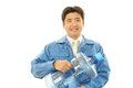 Worker with a container of water smiling asian isolated on white background Royalty Free Stock Photos