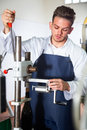Worker corking sparkling wine Royalty Free Stock Photo