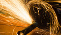 Worker cuts a metal pipe Royalty Free Stock Photo