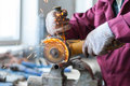 The worker cuts a metal pipe. Royalty Free Stock Photo