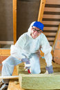 Worker cutting insulating material in overall is with gloves and knife Stock Photos