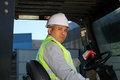 Worker driver of a forklift Royalty Free Stock Image